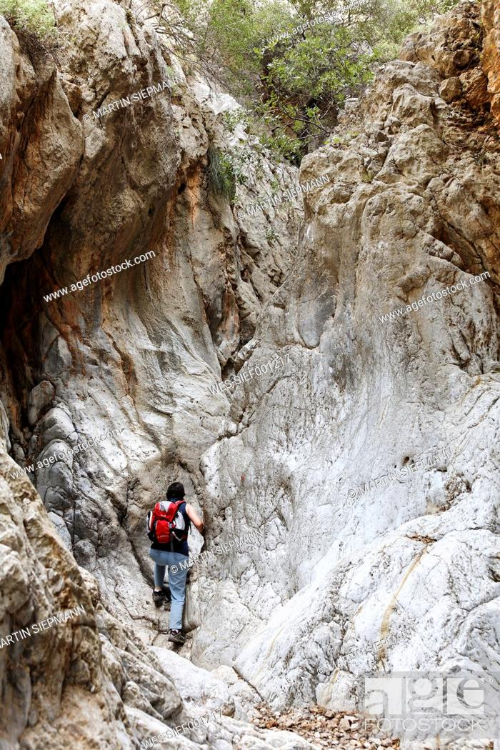 Stock Photo: Greece, Crete, Kritsas Gorge, Mature woman hiking near gorge.