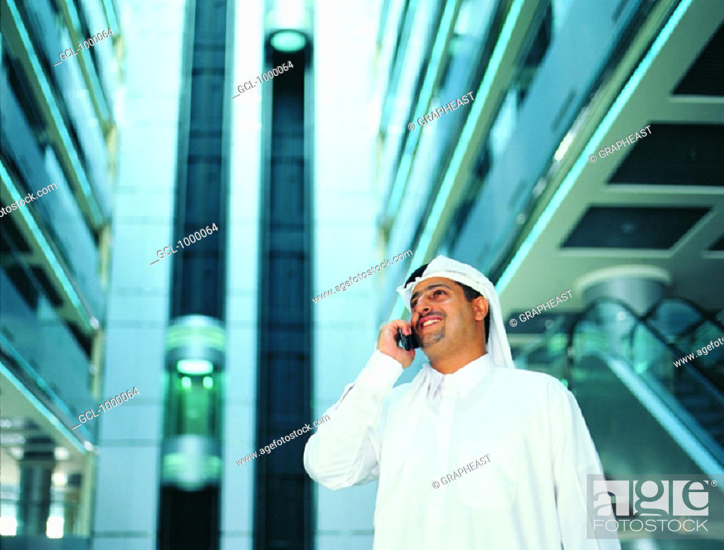 Stock Photo: Arab businessman using cell phone.