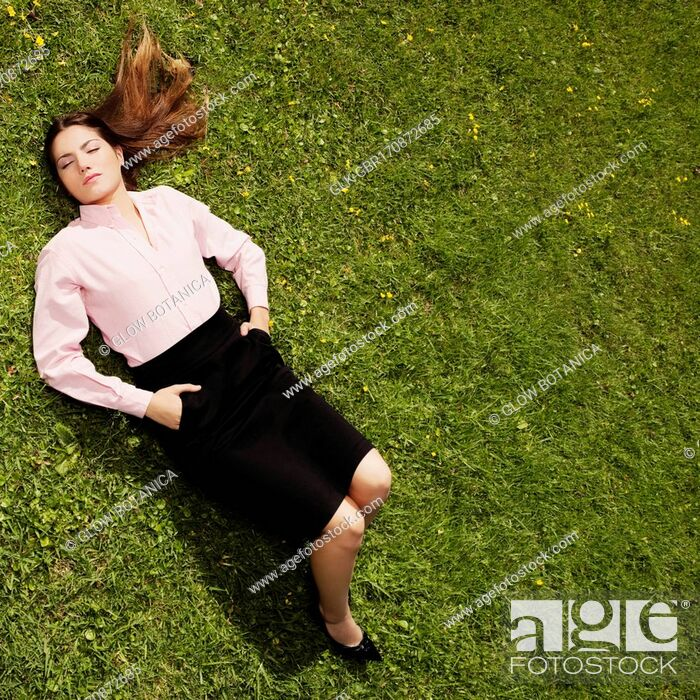 Stock Photo: Teenage girl sleeping in a park.
