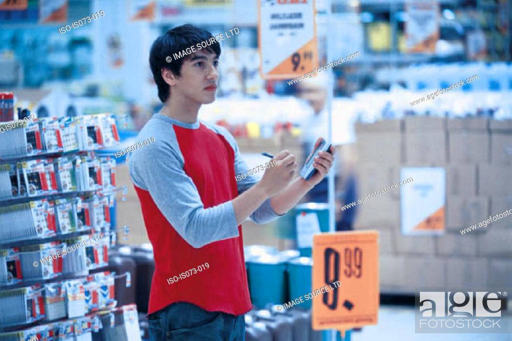 Stock Photo: Man in superstore.