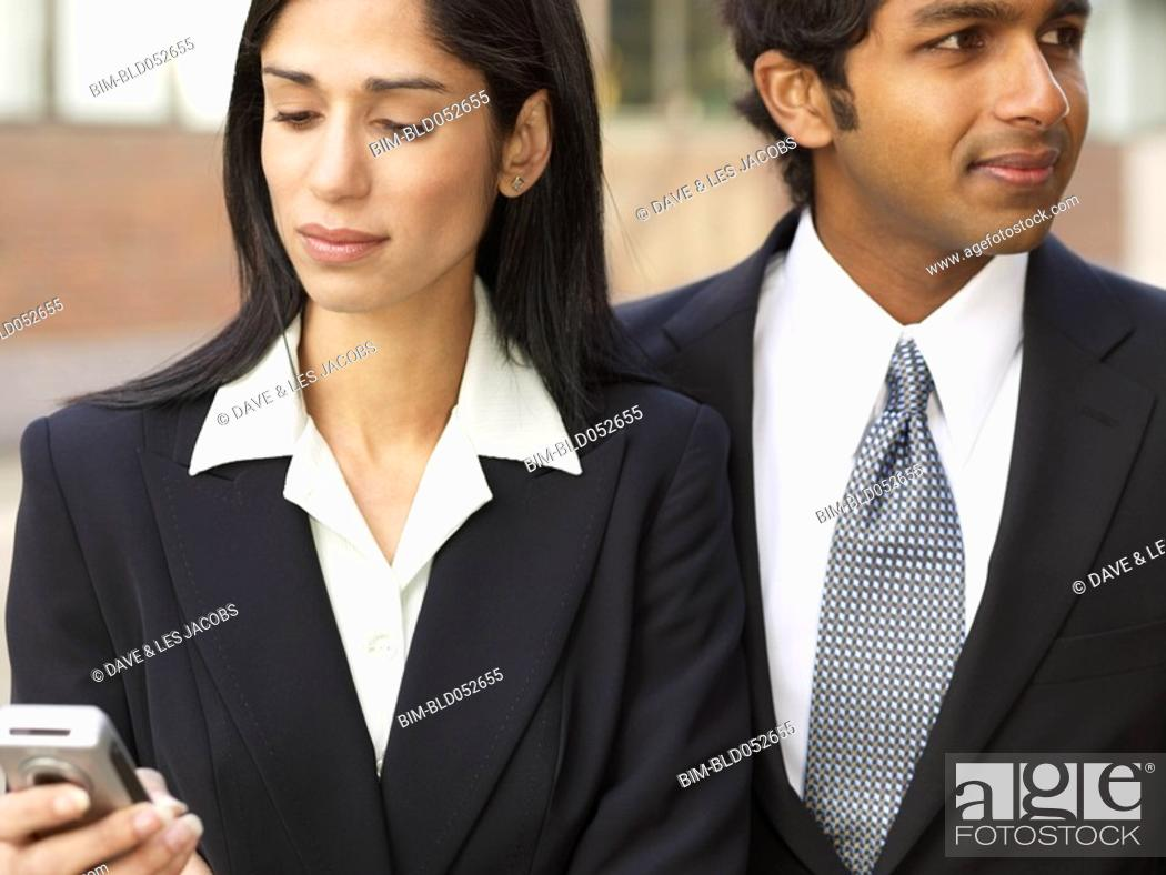 Stock Photo: Multi-ethnic businesswoman and businessman outdoors.