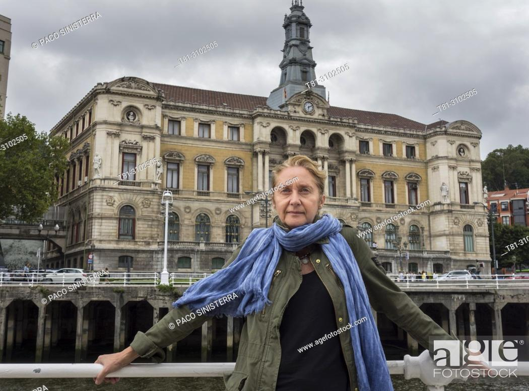 Stock Photo: Portrai of woman in front of the city hall of Bilbao, Basque Country, Spain.