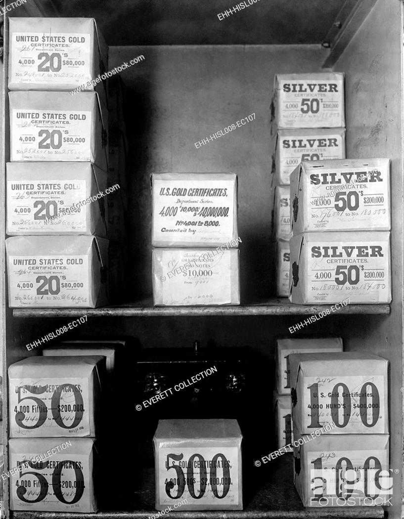 Stock Photo: Cash vault of the United States Treasury holds packages of Gold and Silver certificates worth over 80 million dollars. In 1914, the U.S.