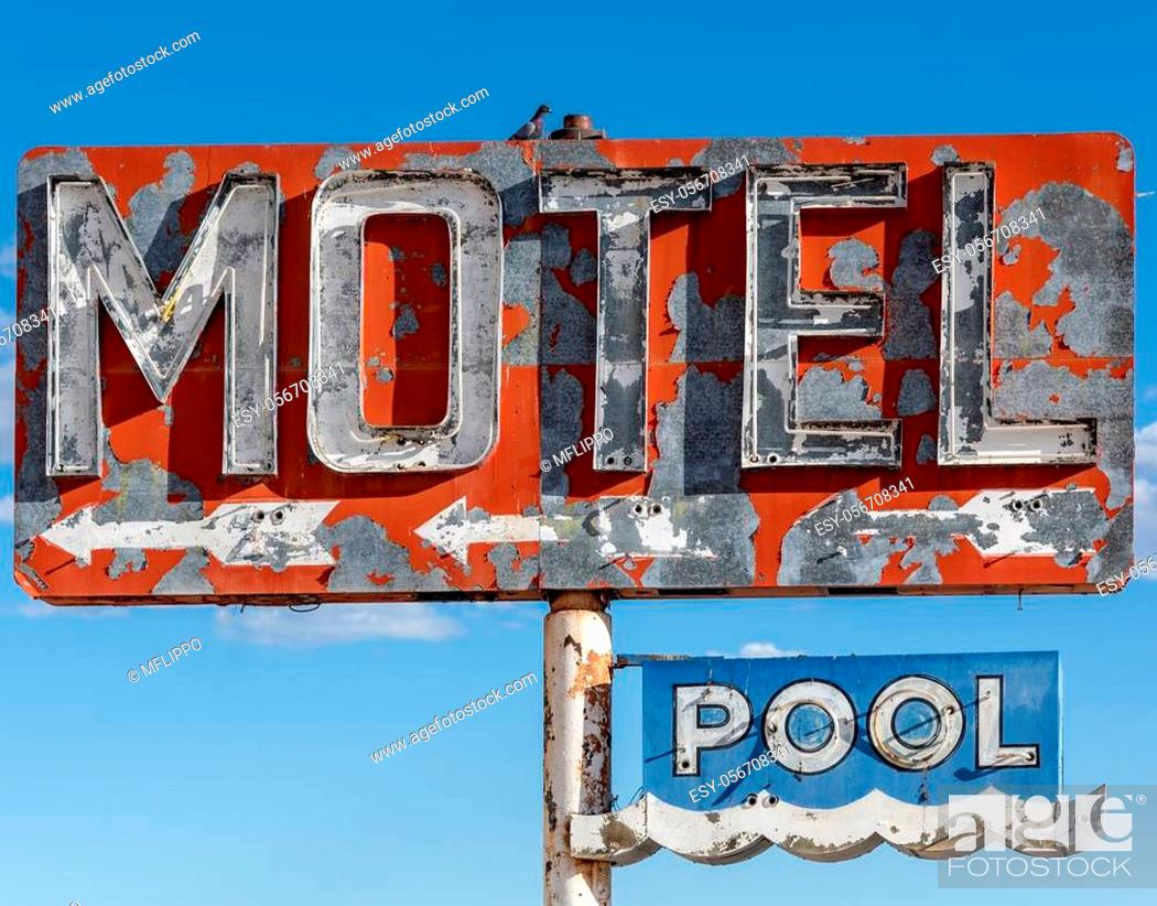 Stock Photo: A dilapidated, classic, vintage motel sign in the desert of Arizona.