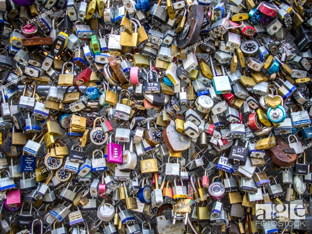 Stock Photo: Full frame of padlocks attached to chain link fence, San Antonio, TX.