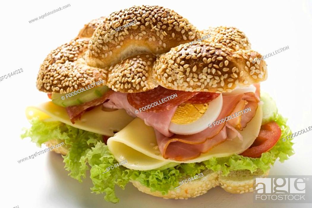 Stock Photo: Ham, salami, cheese and egg sandwich.