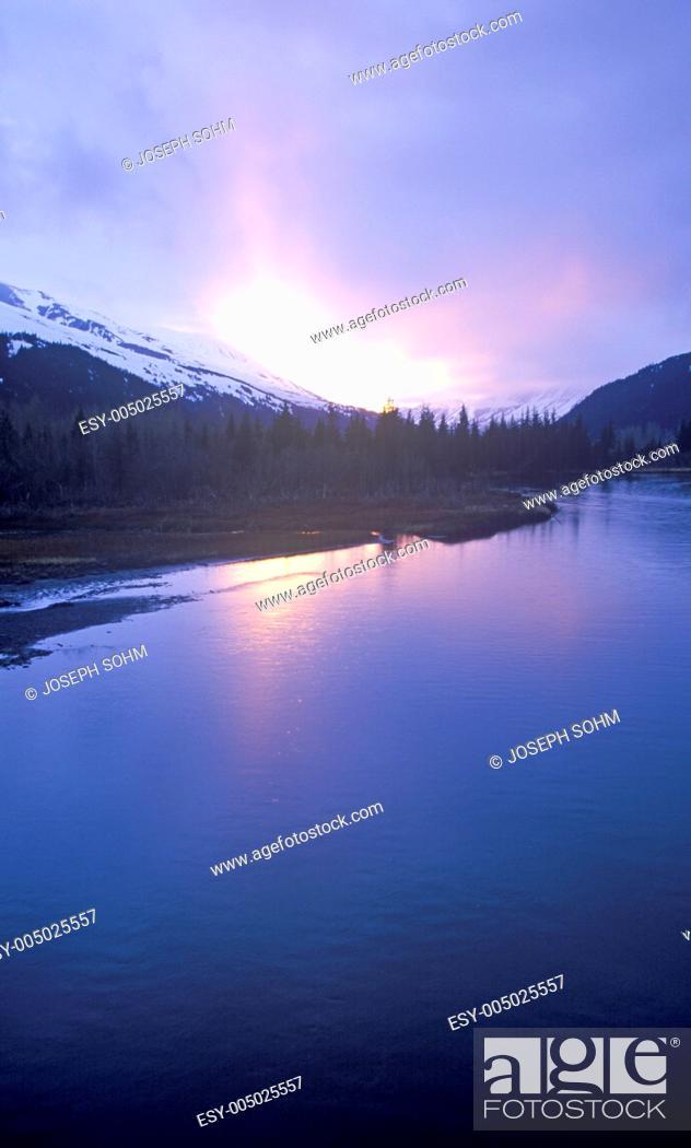 Stock Photo: Sunset on Resurrection River with Harding Ice field in distance, Kenal Mountains, Seward, Alaska.