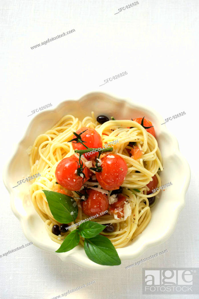 Stock Photo: Spaghetti with cherry tomatoes, olives, cheese and basil.