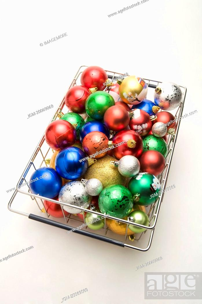 Stock Photo: A basket of colorful Christmas baubles.