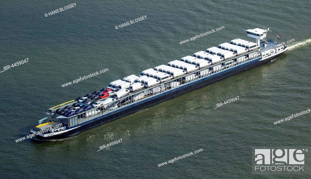 Stock Photo: Forenso cargo ship, car cargo ship, cargo ship with small trucks, inland waterways, river Rhine at Rheinberg, Ruhr district, North Rhine-Westphalia, Germany.