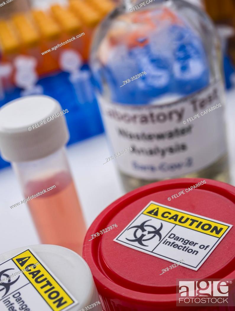 Stock Photo: Scientific analysis of wastewater sample in laboratory, investigation of possible contamination by Sars-Cov-2 in humans, conceptual image.