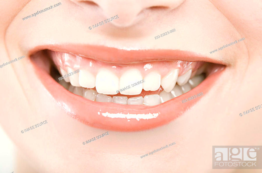 Stock Photo: A womans smiling mouth.
