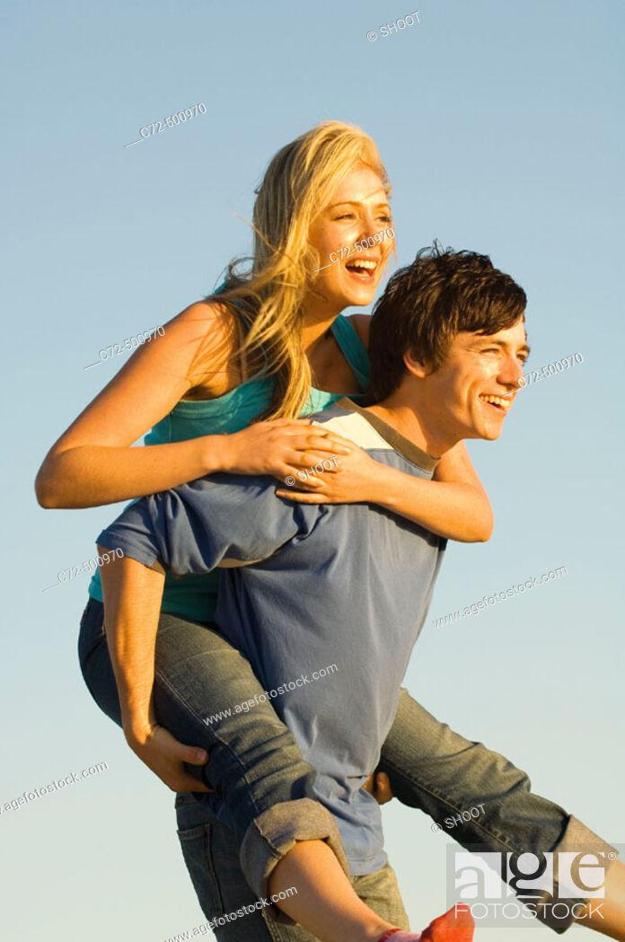 Stock Photo: Couple having fun, piggy back riding.