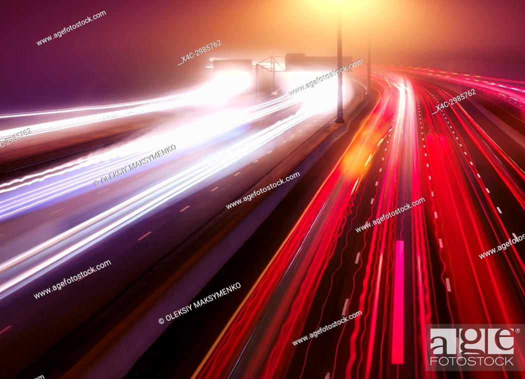 Stock Photo: Artistic abstract traffic light trails. Busy highway traffic on a misty night, Highway 401, Toronto, Ontario, Canada.
