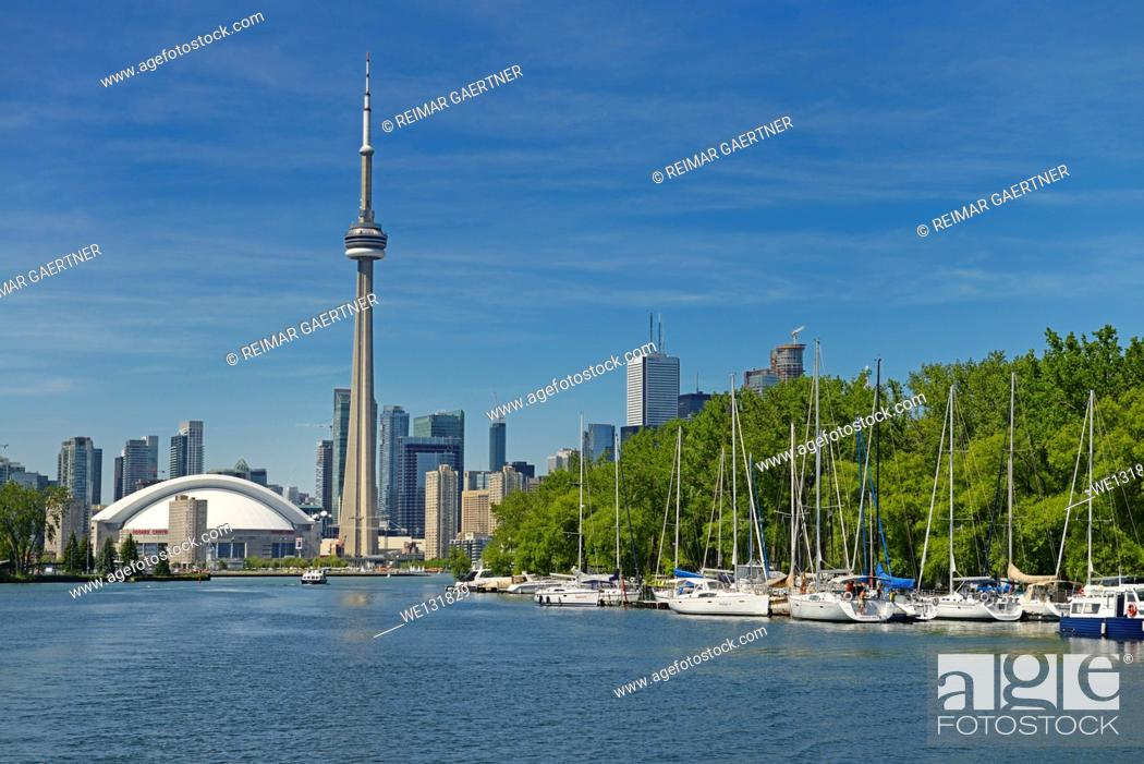 Stock Photo: Toronto skyline and Island Yacht Club sailboats from Blockhouse Bay between Hanlan and Muggs Islands.