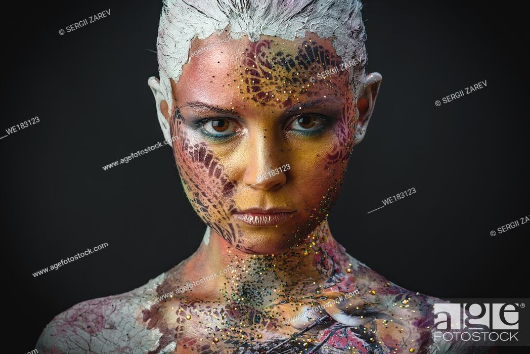 Stock Photo: Portrait of Beautiful Young Woman with creative fantasy bird makeup.