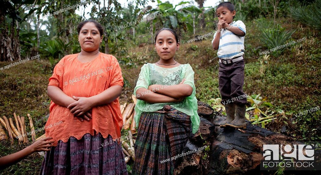 Stock Photo: Chahal, Alta Verapaz, Guatemala, young maya tribe girls and a boy are watching me.