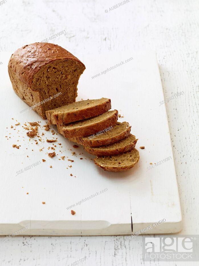 Stock Photo: Sliced granary bread loaf.