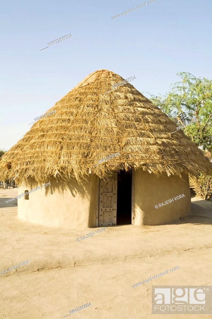 Stock Photo: Bhunga traditional circular house with mud walls and thatched conical roof , Kutch , Gujarat , India.