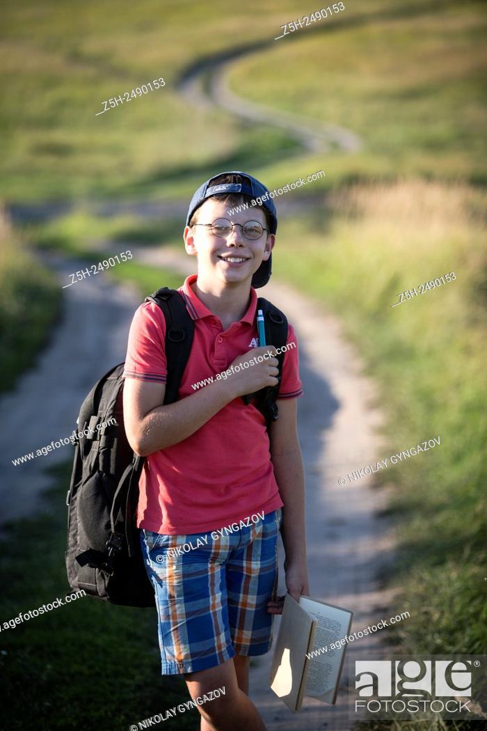 Stock Photo: Russia. Belgorod region. Solomino village. The boy goes to the village school.