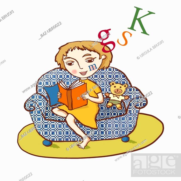 Stock Photo: A young girl reading in a comfy arm chair.