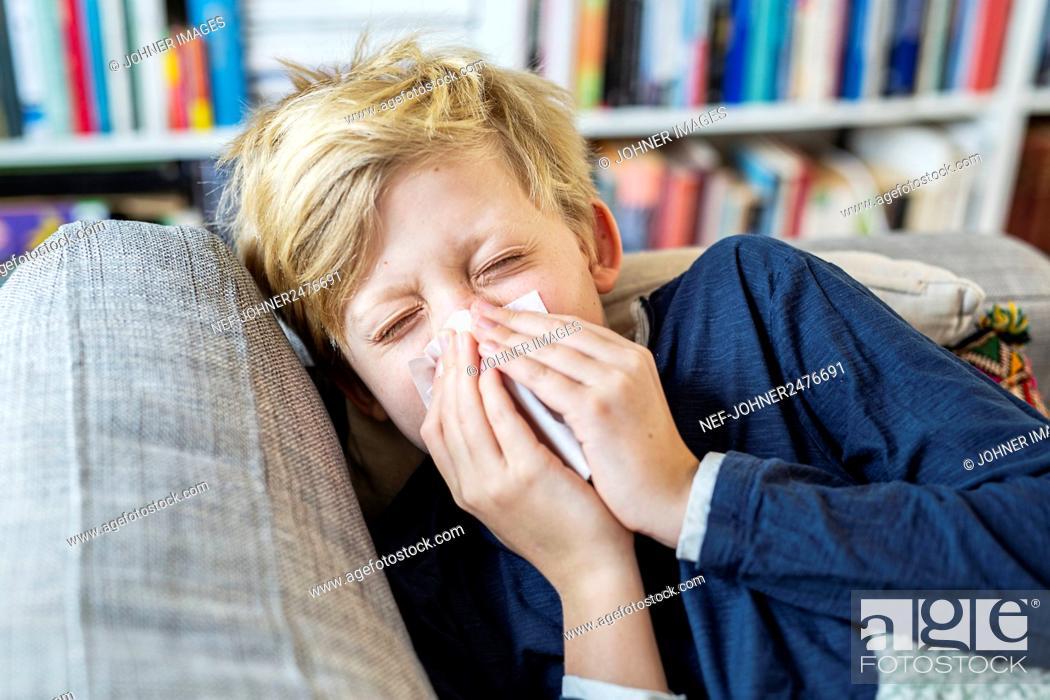 Stock Photo: Boy sneezing.