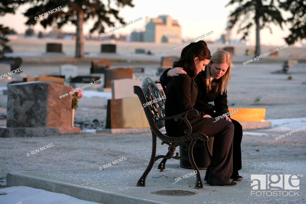 Stock Photo: Two women praying together.