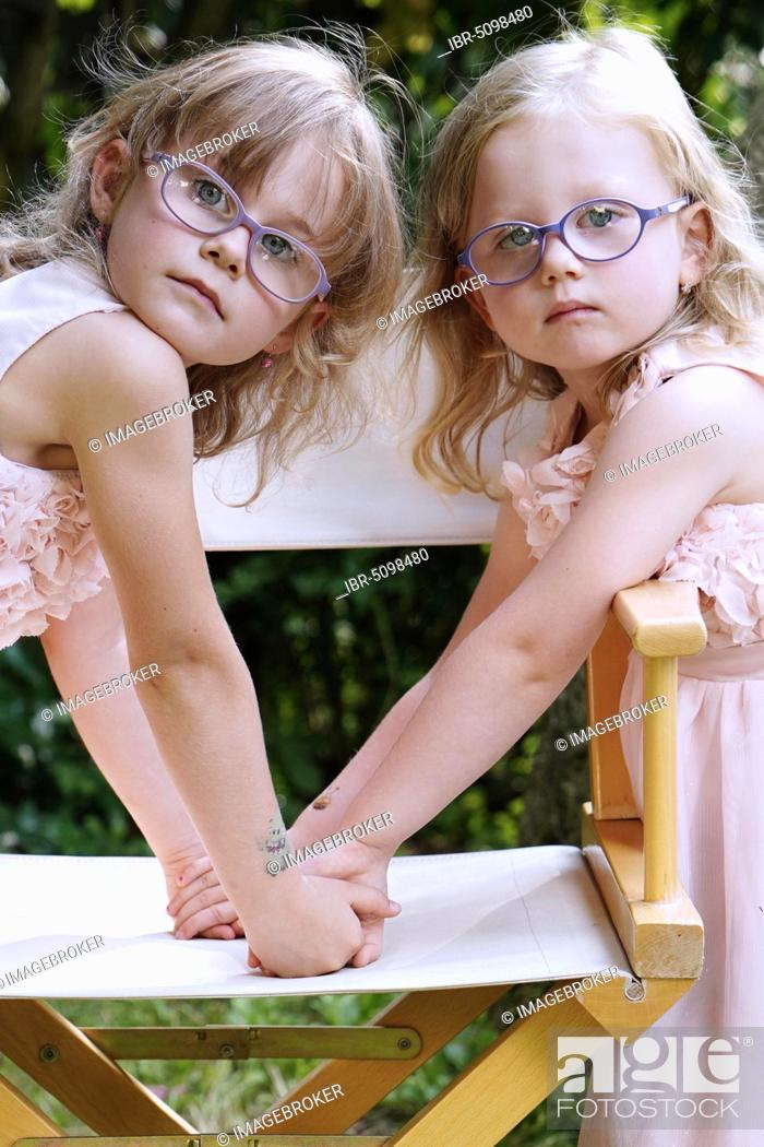 Stock Photo: 6 years old, 3 years old, two girls, siblings, portrait, Czech Republic, Europe.