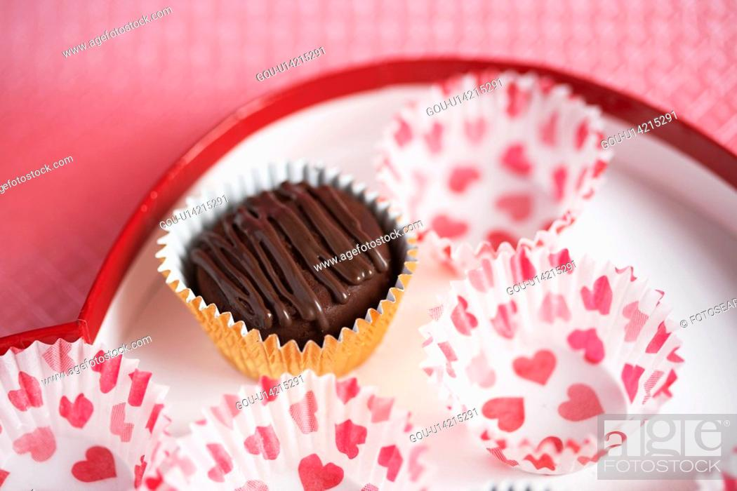 Stock Photo: Chocolate and candy papers on plate (close-up).