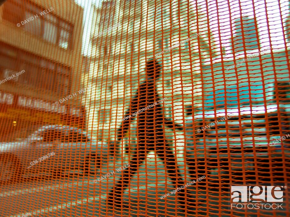 Stock Photo: Net against man crossing the road in in New York, New York.
