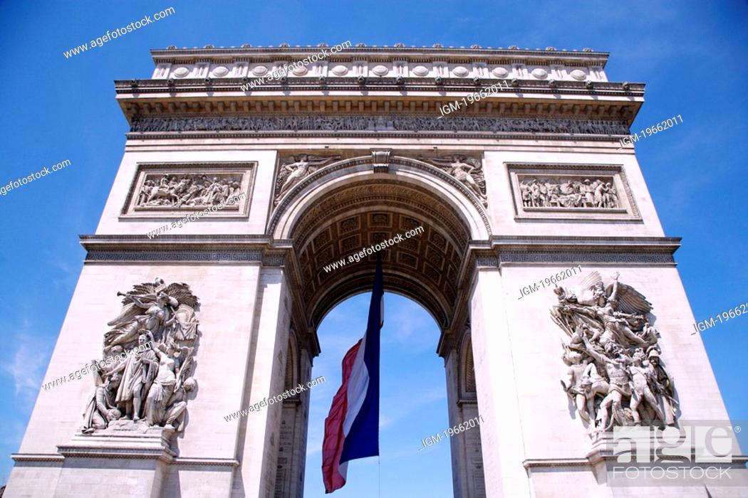Stock Photo: Arc de Triomphe and French flag, low angle view, Paris.