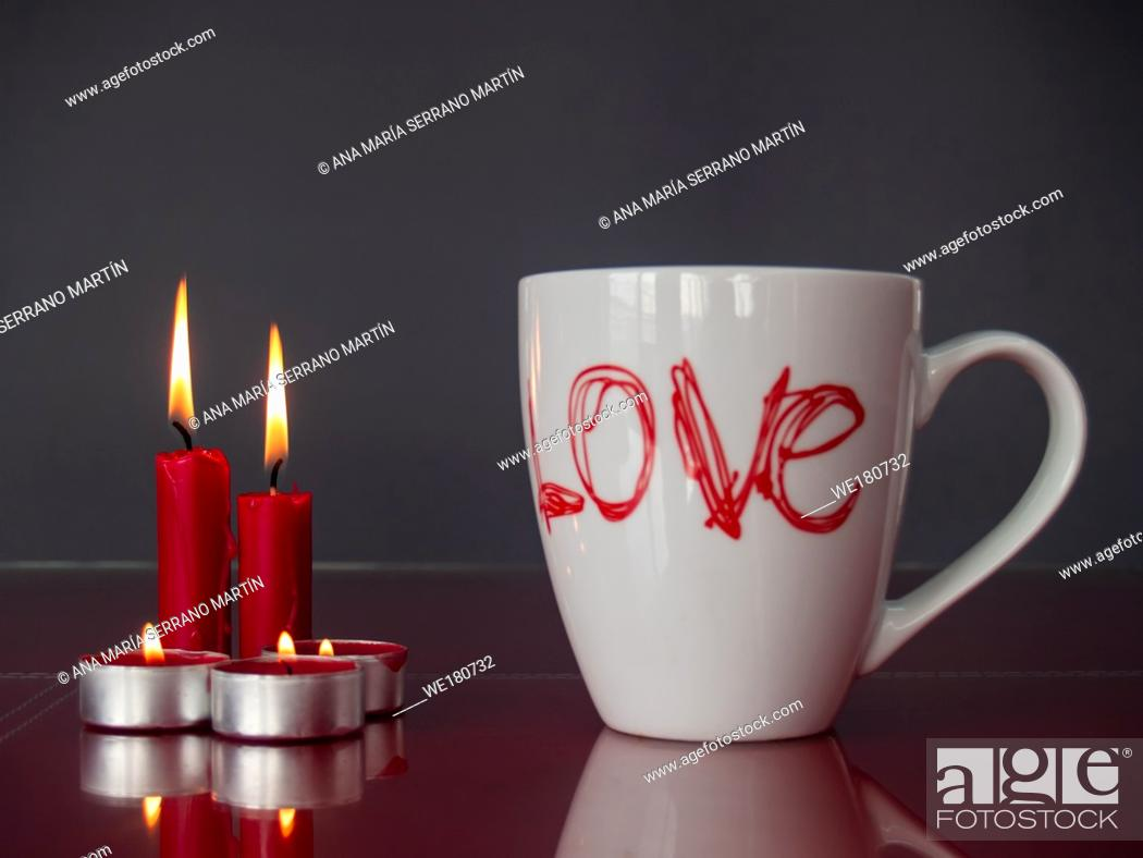 Stock Photo: Concept of love Still life with red lit candles and a breakfast cup with the word love.