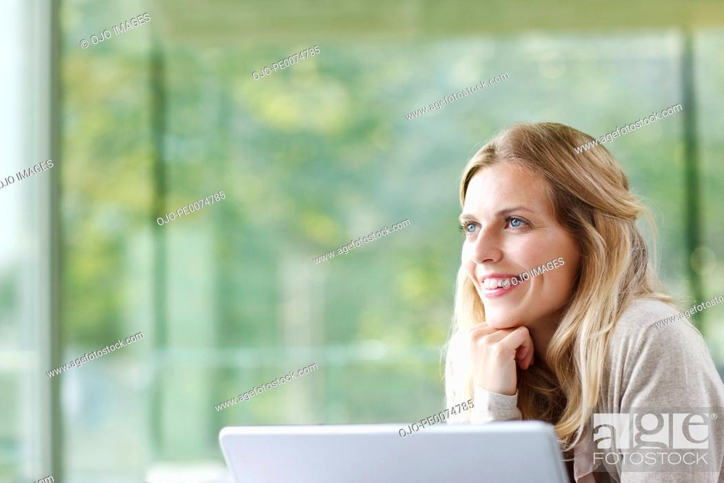 Stock Photo: Smiling woman daydreaming.