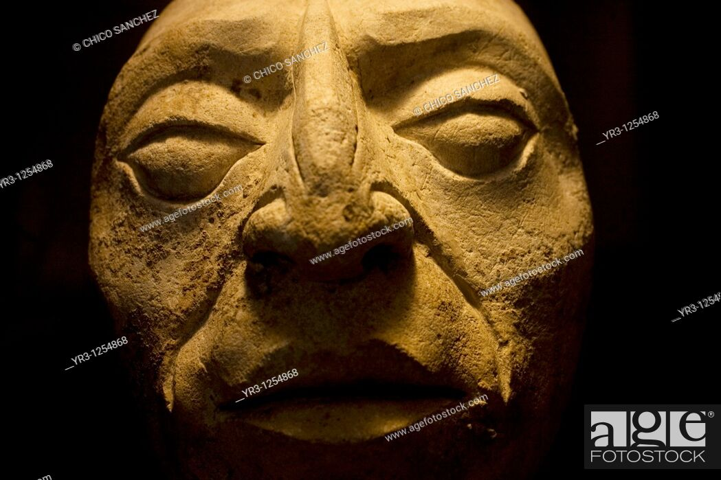 Stock Photo: A human head sculpture sits on display in the museum at the ancient Mayan city of Palenque, Chiapas, Mexico.