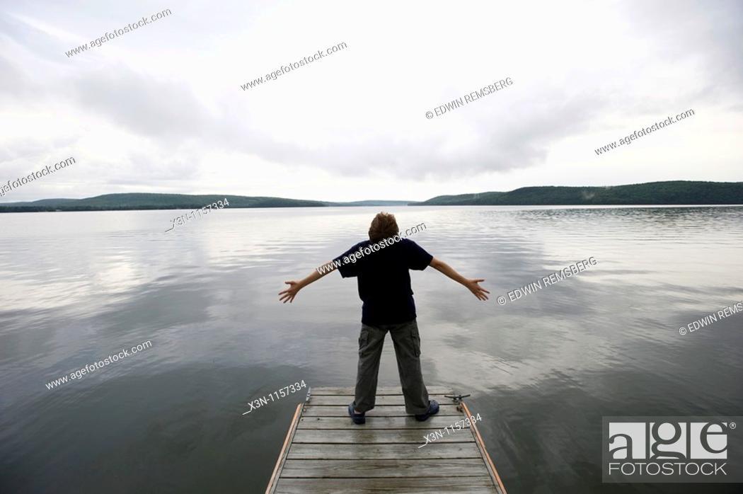 Stock Photo: Boy on dock.