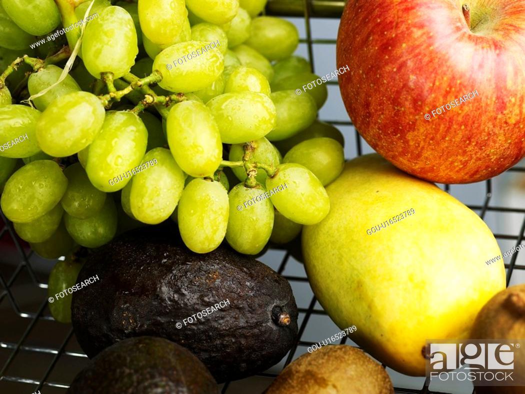 Stock Photo: kiwi, grape, mango, oval kumquat, green grape, shopping cart.