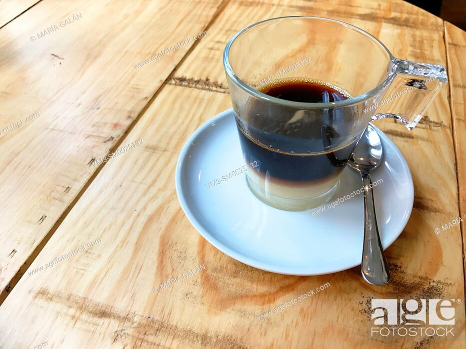 Stock Photo: Cup of Bombon coffee on wooden table.