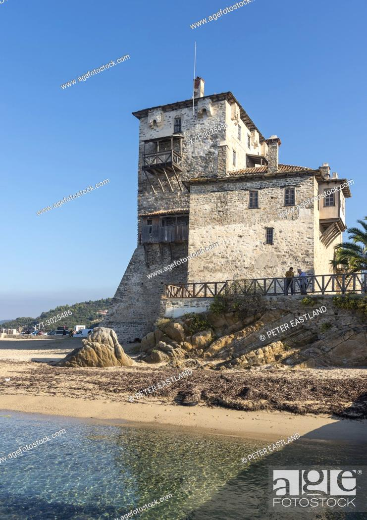 Stock Photo: The Prosphorios tower, on the beach at Ouranoupoli, (at the top of the Athos Peninsula) Chalkidiki, Macedonia, Northern Greece.