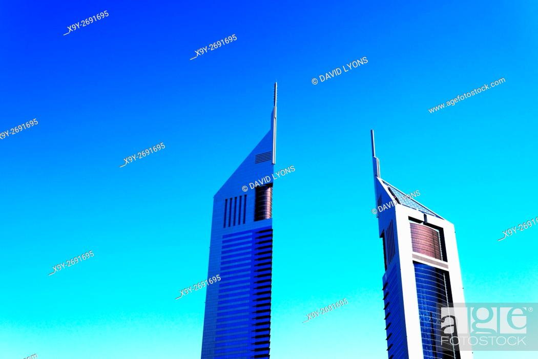 Stock Photo: The Emirates Towers complex, Dubai, United Arab Emirates. Left is Emirates Office Tower. Right is Jumeirah Emirates Towers Hotel.