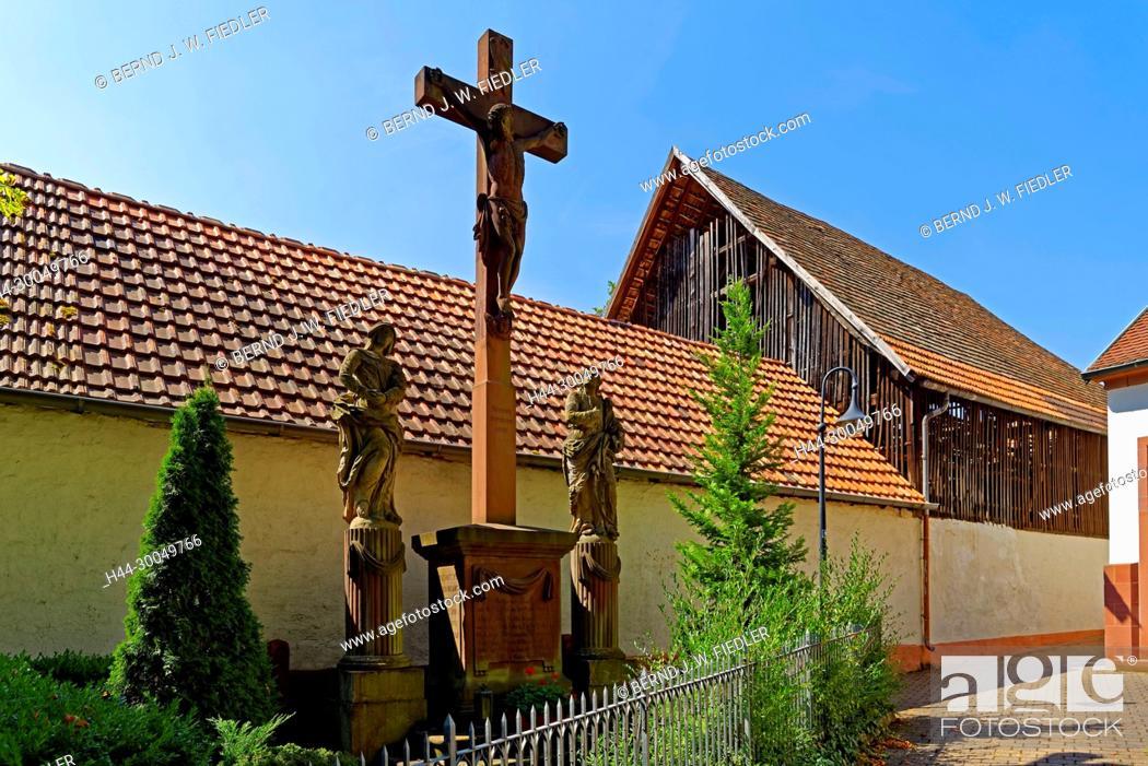 Stock Photo: Parochial garden, cross, stone figures, home Herx Germany.