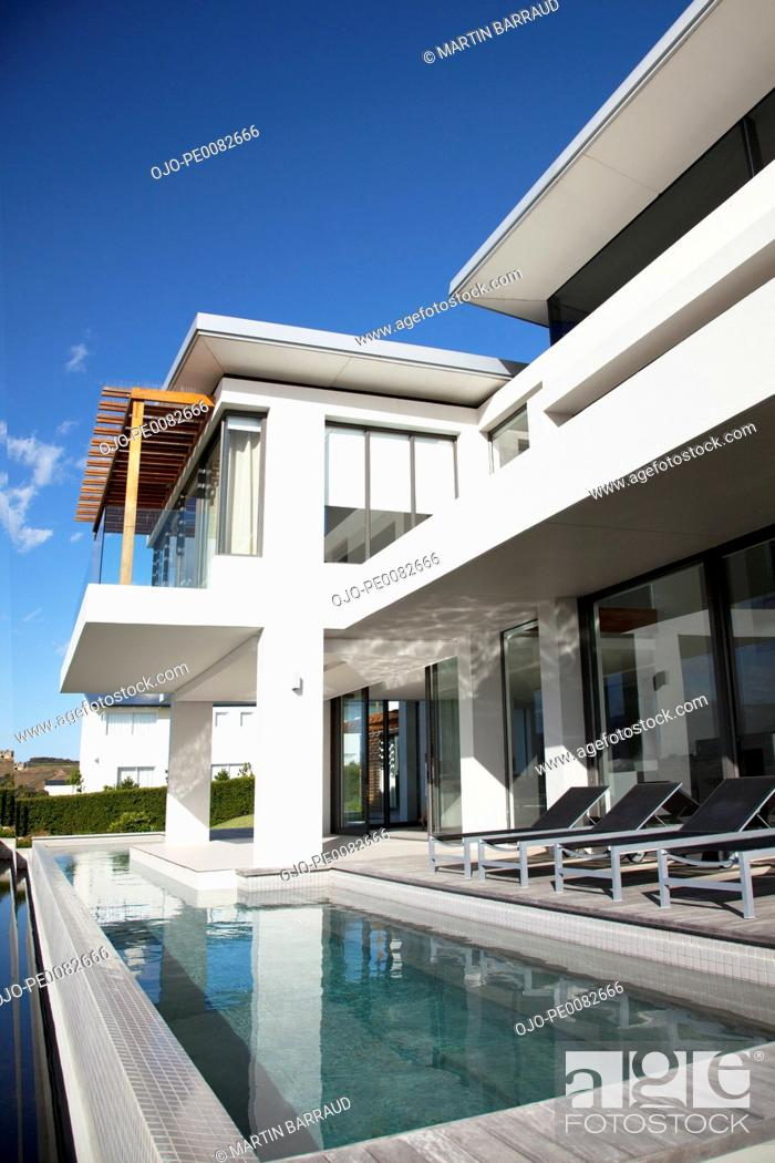 Stock Photo: Modern house with swimming pool.