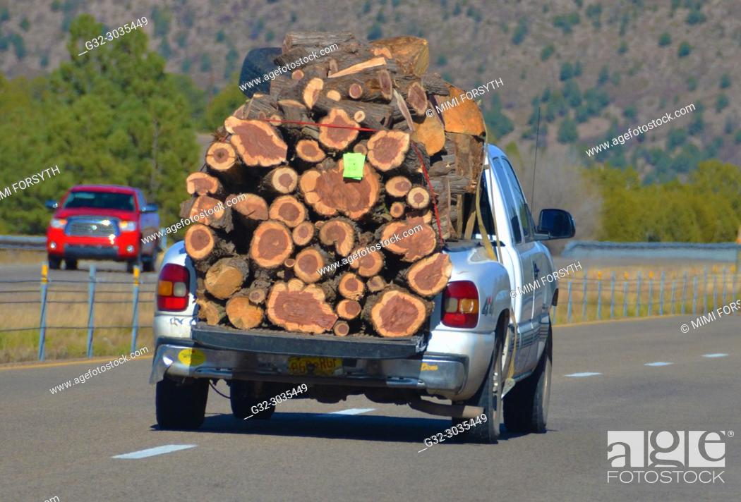 Stock Photo: taking home winter firewood, New Mexico.