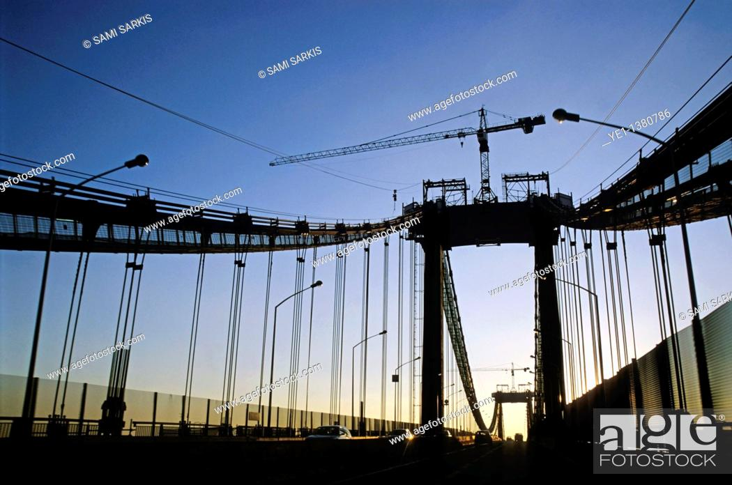 Stock Photo: Road traffic on the silhouetted Pont D'Aquitaine, Bordeaux, Gironde, France.