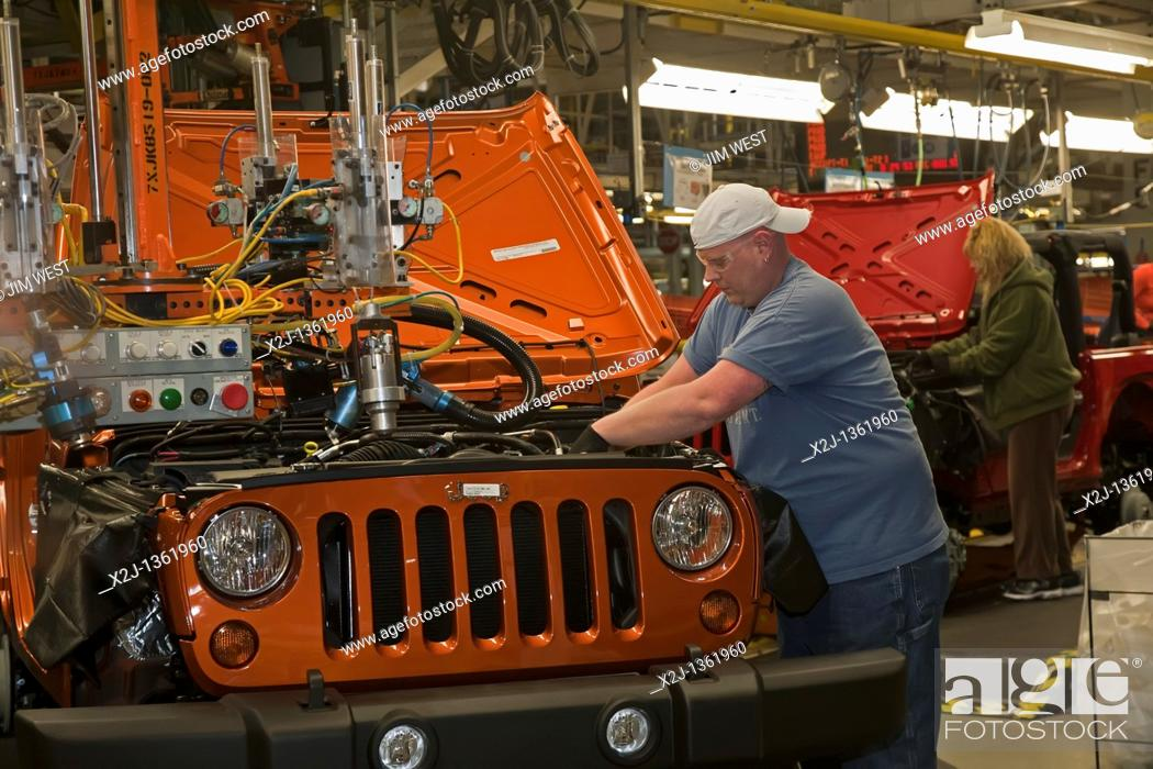 Stock Photo: Toledo, Ohio - Workers assemble a Jeep at a Chrysler assembly plant.