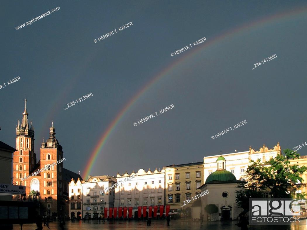 Stock Photo: Rainbow over Mary the Virgin Basilica at Main Market Square, Krakow, Poland, Europe.