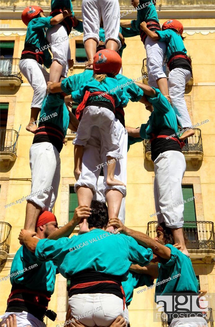 Stock Photo: Castellers de Vilafranca 'Castellers' building human tower, a Catalan tradition Festa de Santa Tecla, city festival  Plaça de la Font Tarragona, Spain.