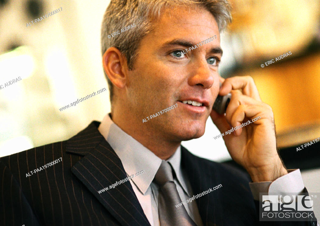 Stock Photo: Businessman talking on cell phone, head and shoulders.