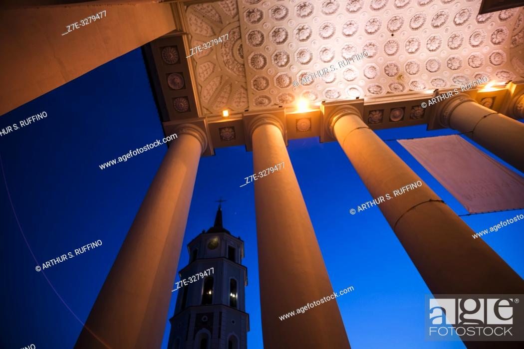 Stock Photo: Night view of Vilnius Belfry (Bell Tower) framed through the portico columns of the Cathedral Basilica of St. Stanislaus and St. Ladislaus.