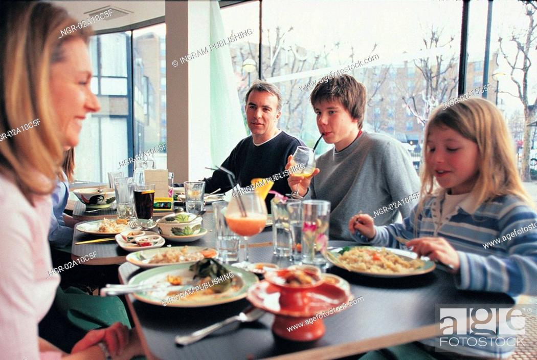 Stock Photo: a family eating out.