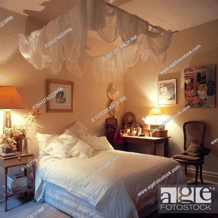Stock Photo Bedroom With White Voile Canopy And Soft Lighting